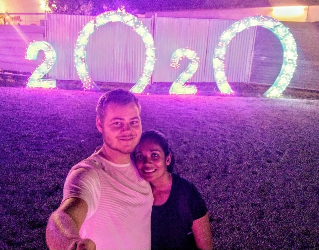 Morgan and Lari together in front of a 2020 sign