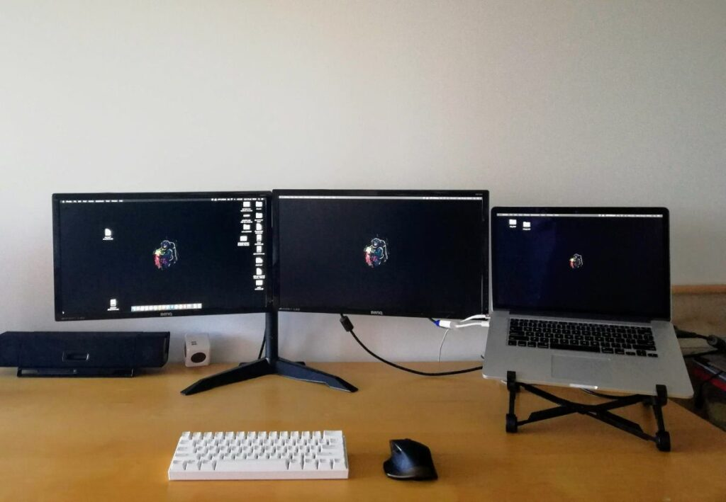 Computer setup with triple monitors in Brisbane Australia
